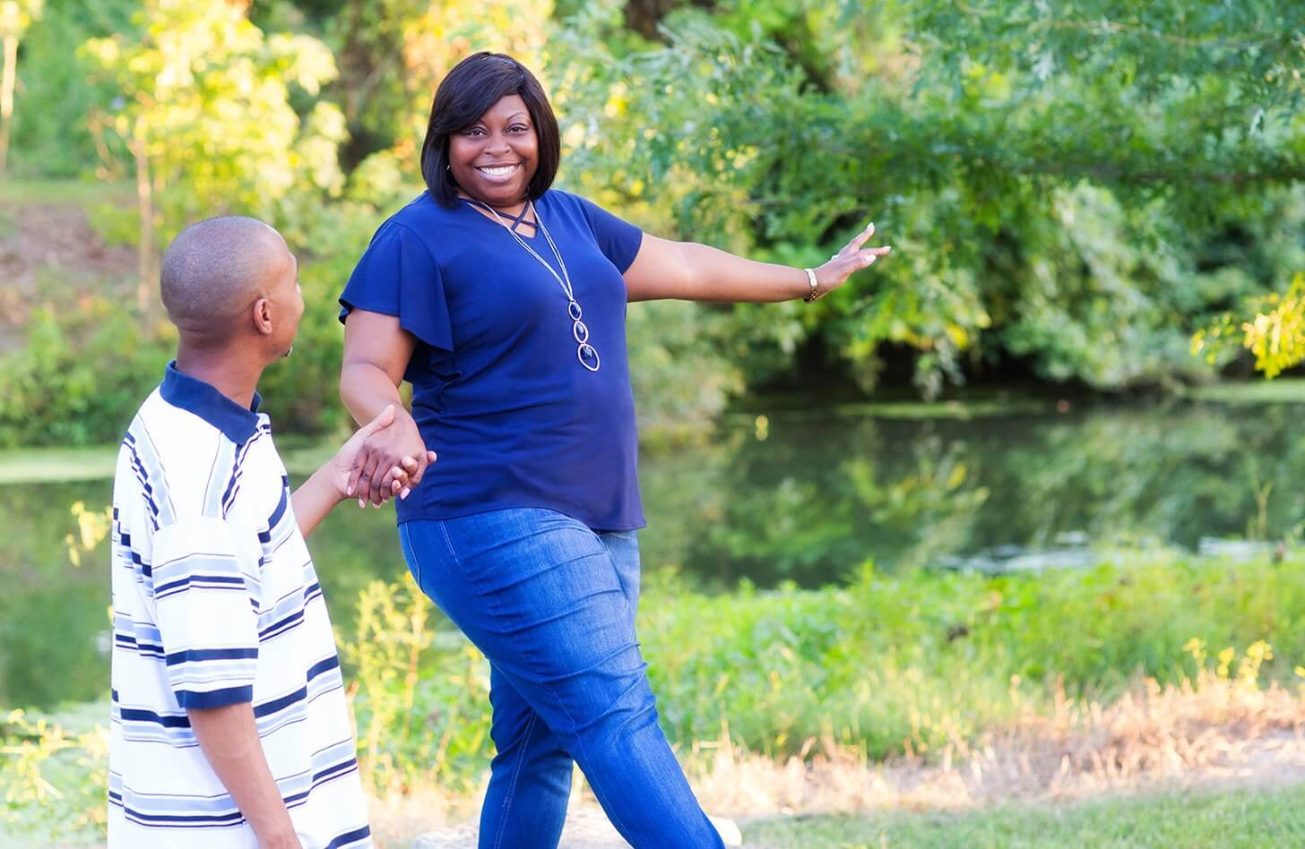 Kidney and pancreas recipient, Nikki Love-McIntyre, walks in Forest Park with her husband.